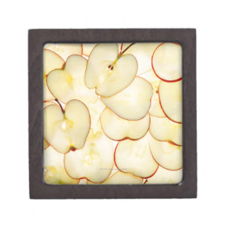 apple slices backlit and arranged in abstract jewelry box