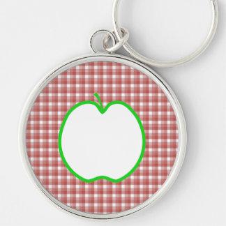 Apple verde con el modelo rojo y blanco del contro llavero redondo plateado