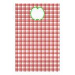 Apple verde con el modelo rojo y blanco del contro papelería de diseño