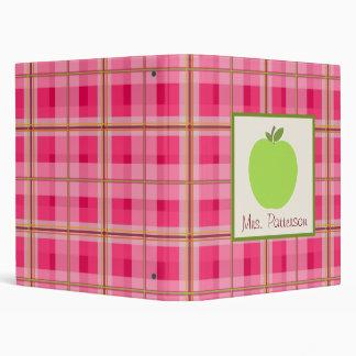 Apple verde y carpeta rosada del profesor de la