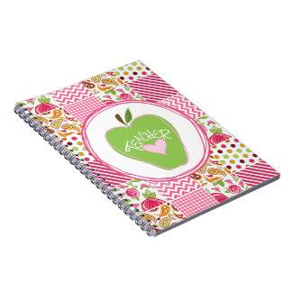 Apple y cuaderno verdes del profesor del remiendo
