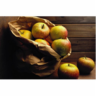 Apples falling from paper bag cut out