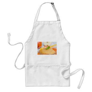 Applesauce with cinnamon and orange spoon adult apron