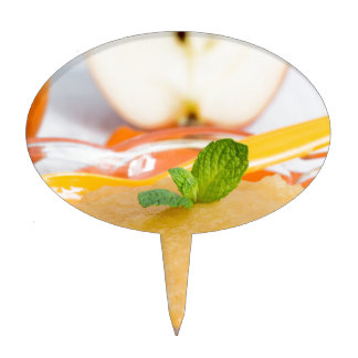 Applesauce with cinnamon and orange spoon cake topper