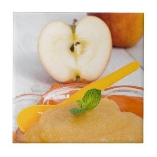Applesauce with cinnamon and orange spoon ceramic tile