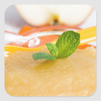 Applesauce with cinnamon and orange spoon square sticker