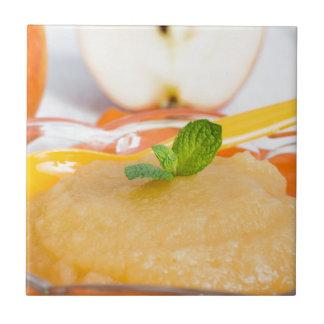 Applesauce with cinnamon and orange spoon tile