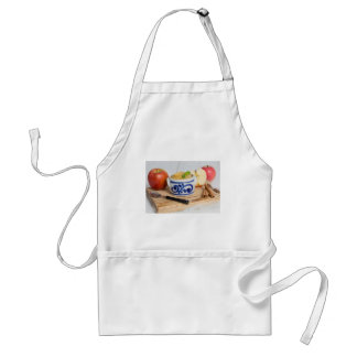Applesauce with cinnamon in stoneware bowl adult apron