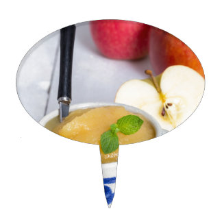 Applesauce with cinnamon in stoneware bowl cake topper