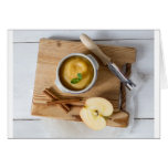 Applesauce with cinnamon in stoneware bowl card