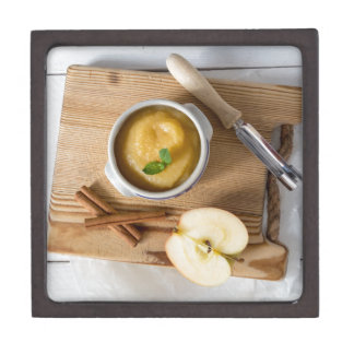 Applesauce with cinnamon in stoneware bowl gift box
