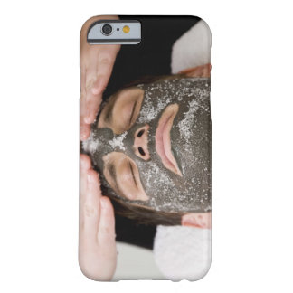 Applying skincare face mask with salt barely there iPhone 6 case