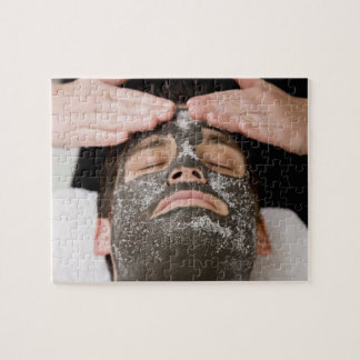 Applying skincare face mask with salt jigsaw puzzle