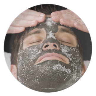 Applying skincare face mask with salt melamine plate
