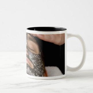 Applying skincare face mask with salt Two-Tone coffee mug
