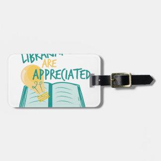 Aprecian a los bibliotecarios etiquetas para equipaje