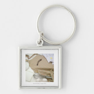 Apron with eggs and whisk Silver-Colored square keychain