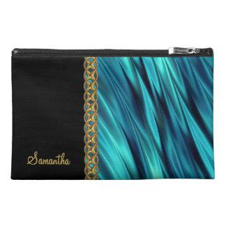 Aqua, black, gold chain, monogram travel accessory bag