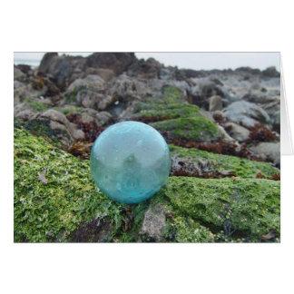 Aqua float on greenery at tide pool card