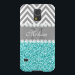 "AQUA GLITTER, GRAY CHEVRON, MONOGRAMMED GALAXY S5 CASE<br><div class=""desc"">GIRLY MODERN PRINTED AQUA BLUE GLITTER (PRINTED PHOTO EFFECT) WITH GRAY AND WHITE CHEVRON PATTERN, MONOGRAMMED WITH YOUR NAME, YOUR INITIAL OR MONOGRAM ON A GRAY STRIPE OR BAND WITH A BORDER OF PRINTED WHITE DIAMONDS. TRENDY, CHIC, COOL, CUTE DESIGN FOR HER, THE TRENDSETTER, THE FASHIONISTA. Design by Elke Clarke&#169;...</div>"