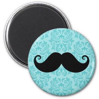 Aqua handlebar mustache on black damask pattern 2 inch round magnet