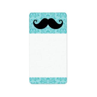 Aqua handlebar mustache on black damask pattern label