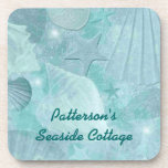 """Aqua Sea Shell Custom Coasters<br><div class=""""desc"""">Lovely custom cork back coasters,  with graphics of a pretty aquamarine colored sea shell pattern,  with a slight distressed look.  Text in teal,  at the bottom,  is ready to personalize for yourself or as a lovely gift idea.</div>"""