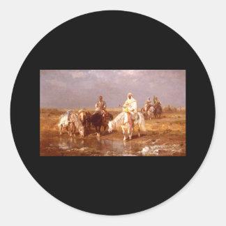 Árabes de Adolfo Schreyer que riegan sus caballos Etiqueta Redonda