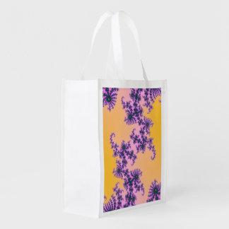 Arabesque del fractal - verde y púrpura en