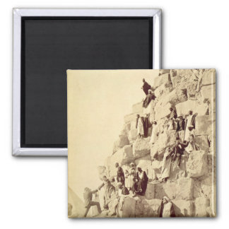 Arabs assisting tourists to climb the pyramids at 2 inch square magnet