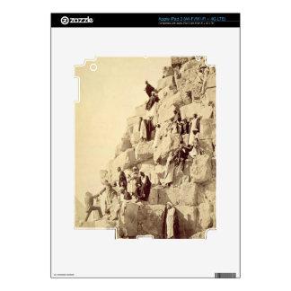 Arabs assisting tourists to climb the pyramids at iPad 3 skin