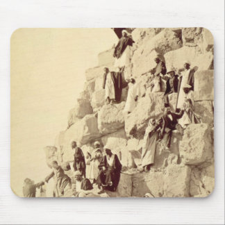 Arabs assisting tourists to climb the pyramids at mouse pad