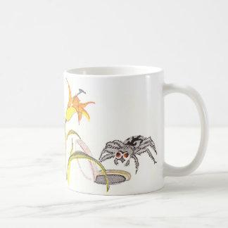 Araña de la trampilla y lirios de día taza de café