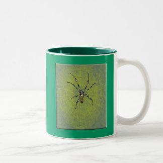 Araña de oro del orbe tazas
