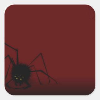 Araña en el pegatina rojo