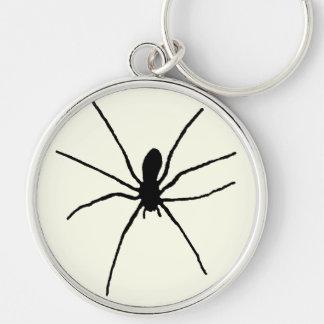 Araña negra llavero redondo plateado