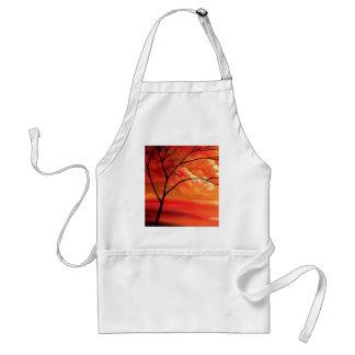 Árbol abstracto y puesta del sol roja delantal