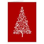 Árbol blanco estilizado en tarjeta roja del día de