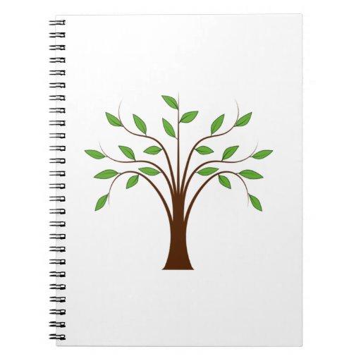 Árbol con las hojas libros de apuntes con espiral