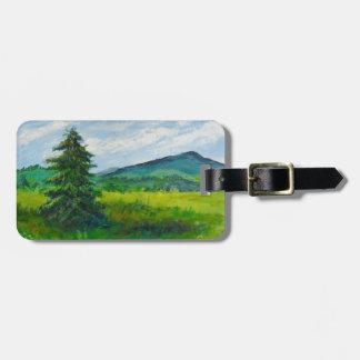 Árbol de hoja perenne del campo pintura de acríli etiquetas maletas