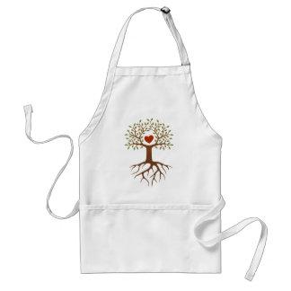 Árbol de la primavera con el corazón y las raíces delantales