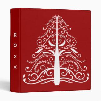 Árbol de navidad anticuado en carpeta roja