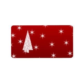 Árbol de navidad blanco con las estrellas en rojo etiquetas de dirección