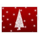 Árbol de navidad blanco con las estrellas en rojo tarjeta