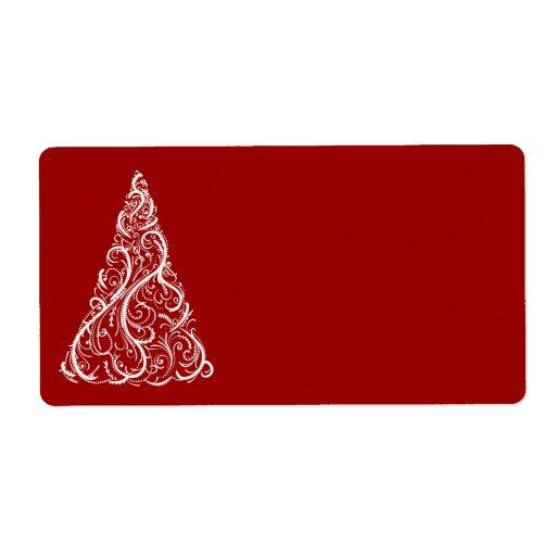 Árbol de navidad blanco en etiqueta de envío roja