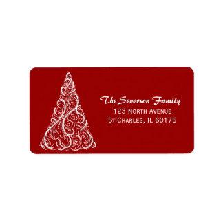 Árbol de navidad blanco en etiqueta roja del etiquetas de dirección