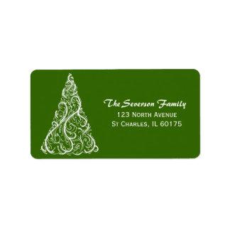 Árbol de navidad blanco en etiqueta verde del etiquetas de dirección