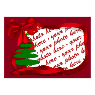 Árbol de navidad con el marco rojo de la foto de l tarjeta de visita
