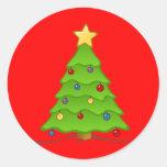 Árbol de navidad con las chucherías y la estrella etiquetas redondas