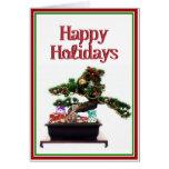 Árbol de navidad de los bonsais felicitaciones